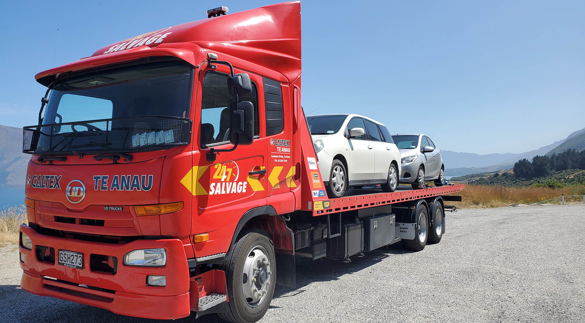 Large red Caltex salvage vehicle with two cars onboard